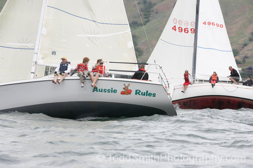 two sailboats pass while beating to windward