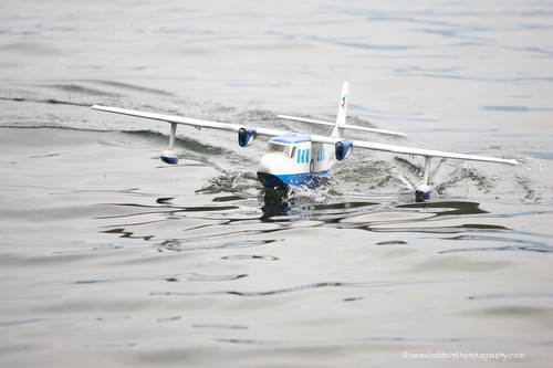 model airplane taxiing on the water