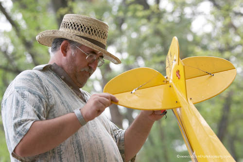 adjusting the tail of a model airplane at the Penticton Model Airplane Club