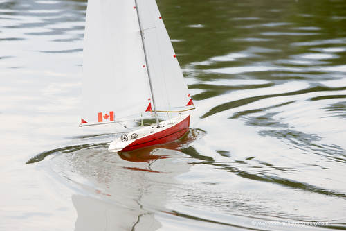 A model sailboat comes about