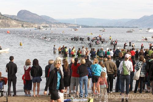 A crowd of swimmer finish the swim at the 2008 Subaru Ironman Canada