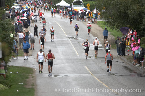 Runners reach the half-way point of their marathon (third section of the Ironman).