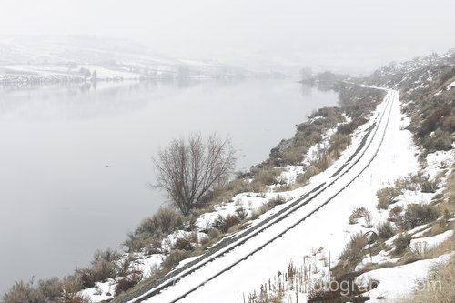 train tracks along the Columbia River in winter