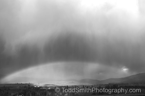 rainbow and clouds in black and white